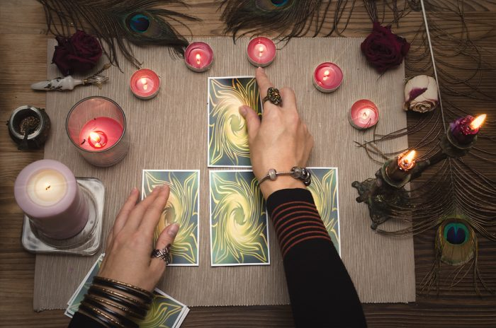 fortune teller using divination cards to predict the future